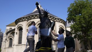 """Workers prepare the """"Liberty Enlightening the World"""" by Frederic Auguste Bartholdi, a mini-replica of the French-designed Statue of Liberty"""