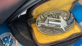 A small firearm tucked in a belt buckle was stopped at a TSA checkpoint at Newark Airport.