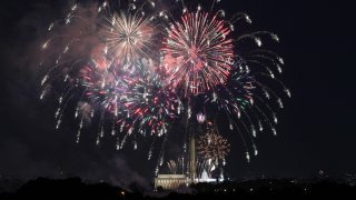 FILE - Fireworks are set off on the National Mall over the Washington Monument, Lincoln Memorial and U.S. Capitol Building as part of celebrations for the 4th of July in Washington, July 4, 2020.