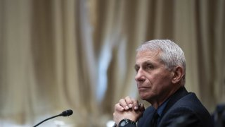 """Anthony Fauci, director of the National Institute of Allergy and Infectious Diseases, listens during a Senate Appropriations Subcommittee hearing in Washington, D.C., U.S., on Wednesday, May 26, 2021. The hearing is titled """"National Institutes of Health's FY22 Budget and the State of Medical Research."""""""