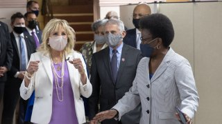First Lady Dr. Jill Biden (L) and Dr. Anthony Fauci (C), Director of the National Institute of Allergy and Infectious Diseases, speak with members of the Abyssinian Baptist Church on June 6, 2021 in New York City