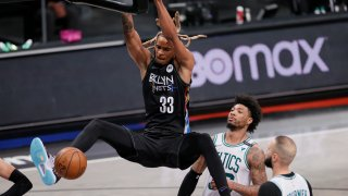 Nicolas Claxton slam dunks