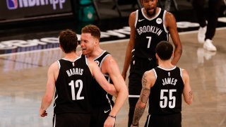 The Brooklyn Nets celebrate during the fourth quarter against the Milwaukee Bucks during Game One of the Eastern Conference second round series at Barclays Center on June 05, 2021 in New York City