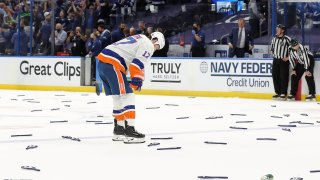 Islanders player with head down