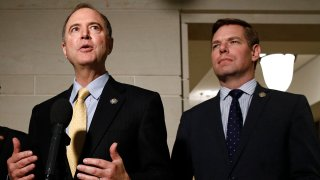 FILE - In this May 28, 2019 file photo, Rep. Adam Schiff, D-Calif., left, and Rep. Eric Swalwell, D-Calif., speak with members of the media on Capitol Hill in Washington.