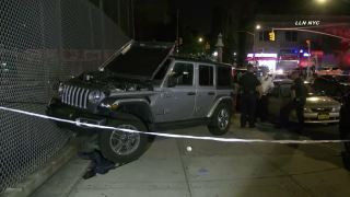 A Jeep crashed into a fence after jumping a curb and hitting six people, police say.