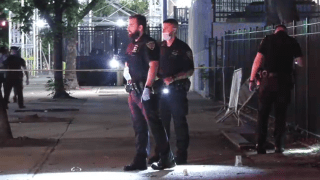 Police collect evidence after a fatal shooting on a Manhattan street.