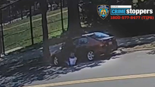 Surveillance video captured the moment a 73-year-old was pulled out from her car on June 5.