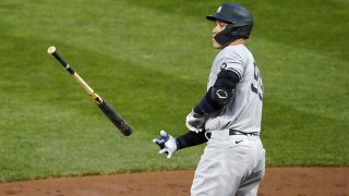 Aaron Judge tosses a bat