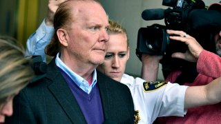FILE - In this May 24, 2019 file photo, chef Mario Batali departs after pleading not guilty, at municipal court in Boston, to an allegation that he forcibly kissed and groped a woman at a Boston restaurant in 2017.