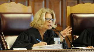 New York Court of Appeals Chief Judge Janet DiFiore, asks questions during oral arguments on whether criminal defendants should be allowed to use allegations made in civil rights lawsuits against police witnesses to question their credibility during cross-examination at the Court of Appeals on Wednesday, June 1, 2016, in Albany, N.Y.