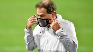 Head coach Nick Saban of the Alabama Crimson Tide puts his mask on during halftime of the College Football Playoff National Championship football game against the Ohio State Buckeyes at Hard Rock Stadium on January 11, 2021 in Miami Gardens, Florida.