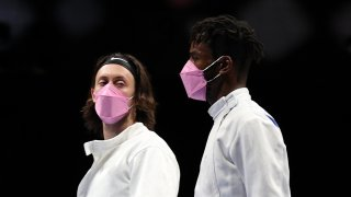 Jacob Hoyle of Team United States, left, and Curtis McDowald of Team United States reacts to their loss to Team Japan in Men's Épée Team Table of 16 on day seven of the Tokyo 2020 Olympic Games at Makuhari Messe Hall on July 30, 2021 in Chiba, Japan.