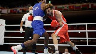 U.S. boxer Keyshawn Davis advances through Round of 16 via TKO of France's Sofiane Oumiha.