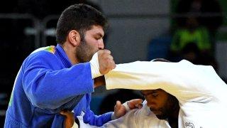 An Israeli judoka competing against a French judoka at Rio 2016