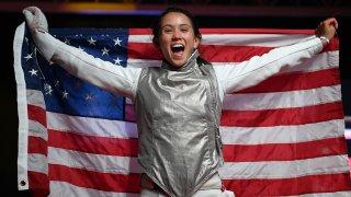 Lee Kiefer celebrates winning a gold medal in women's individual foil
