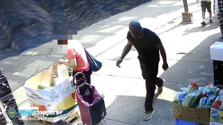 A man seen walking down a street on surveillance video is wanted by police in connection with a violent Queens home invasion.