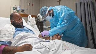 A nurse treats Covid-19 patient Cedric Daniels
