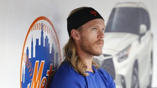 New York Mets pitcher Noah Syndergaard sits in the dugout