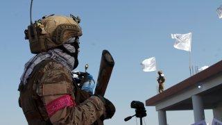 Taliban commando fighters stand guard in Lashkar Gah, Helmand province, southwestern, Afghanistan