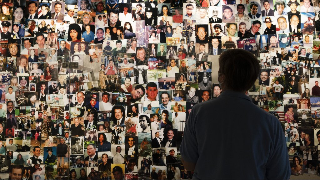 Désirée Bouchat looks at photos of those who perished, in a display at the 9/11 Tribute Museum