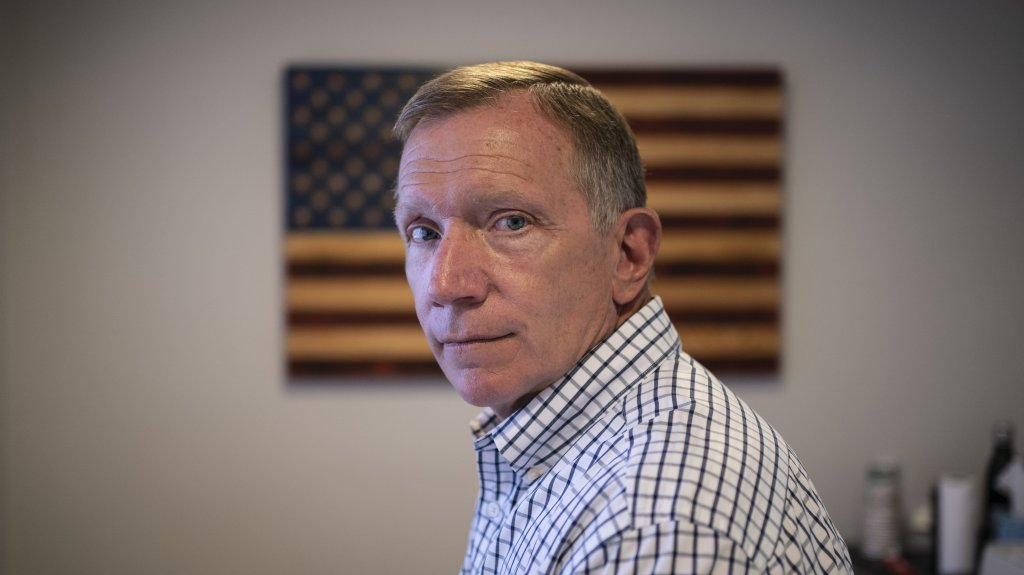 Retired NYPD Officer Ken Winkler, poses for a portrait in his office