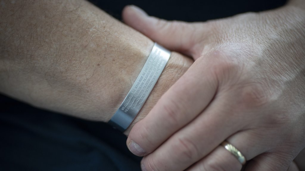 Retired NYPD Officer Mark DeMarco wears a wristband with the names of the 14 ESU members killed on Sept. 11