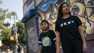 Monica Muquinche and her son Sebastian pose for a photo in their neighborhood in the Brooklyn borough of New York