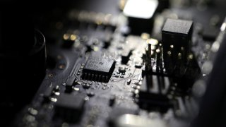 """FILE - This Feb 23, 2019, file photo shows the inside of a computer. Three former U.S. intelligence and military operatives have agreed to pay nearly $1.7 million to resolve criminal charges that they provided sophisticated hacking technology to the United Arab Emirates. A charging document in federal court in Washington accuses them of helping develop """"advanced covert hacking systems for U.A.E. government agencies."""""""