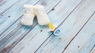 Baby booties on a wooden table