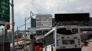 A Metropolitan Transportation Authority (MTA) New York City public bus approaches the Verrazzano-Narrows Bridge in New York