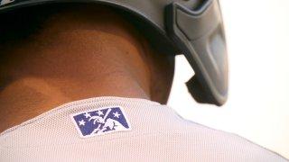 Closeup view of minor league baseball logo on jersey