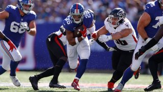 Saquon Barkley #26 of the New York Giants runs the ball during the third quarter in the game against Atlanta Falcons at MetLife Stadium on September 26, 2021 in East Rutherford, New Jersey.