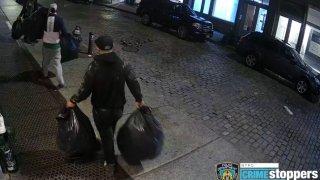 Burglars walking off with stolen goods from store