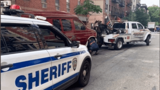 A van towed by city authorities allegedly illegally registered and used as an Airbnb rental.