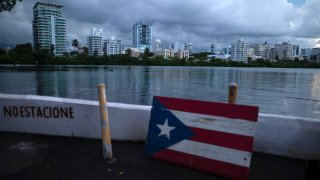 A wooden Puerto Rican flag is displayed on the dock of the Condado lagoon