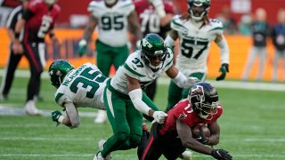 Atlanta Falcons wide receiver Olamide Zaccheaus (17) is challenged by New York Jets cornerback Bryce Hall (37) and New York Jets defensive back Sharrod Neasman (35) during the second half of an NFL football game