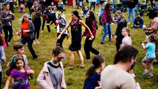 Kerri Helme, center, of the Mashpee Wampanoag Tribal Nation leads attendees in dance during a gathering marking Indigenous Peoples Day at Penn Treaty Park in Philadelphia, Monday, Oct. 11, 2021.