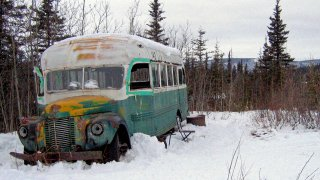FILE - In this March 21, 2006, file photo, is the abandoned bus where Christopher McCandless starved to death in 1992 near Healy, Alaska. The bus that people sometimes embarked on deadly pilgrimages to Alaska's backcountry to visit can now safely be viewed at the University of Alaska Fairbanks while it undergoes preservation work. The bus was moved to the university's engineering facility in early Oct. 2021, while it's being prepared for outdoor display at the Museum of the North, Fairbanks television station KTVF reported.