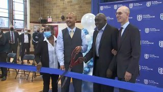 Adam Silver and Earl Monroe at school opening