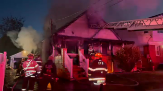 A house in Elmont suffered significant damage after it was fully engulfed in an early morning fire.