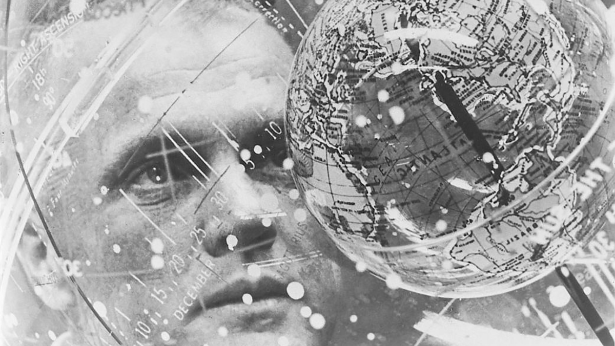 John Glenn looks into a Celestial Training Device globe at the Aeromedical Laboratory at Cap Canveral, Florida, in this February 1962 photo provided by NASA.