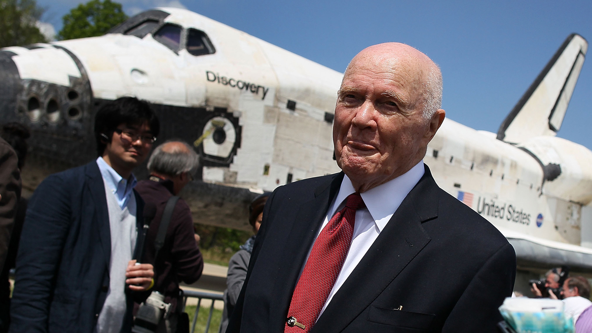 Former astronaut and U.S. Senator John Glenn (D-OH) walks past the Space Shuttle Discovery during an event at the Smithsonian National Air and Space Museum on April 19, 2012, in Chantilly, Virginia. Glenn died Thursday, Dec. 8, 2016. (Photo by Mark Wilson/Getty Images)