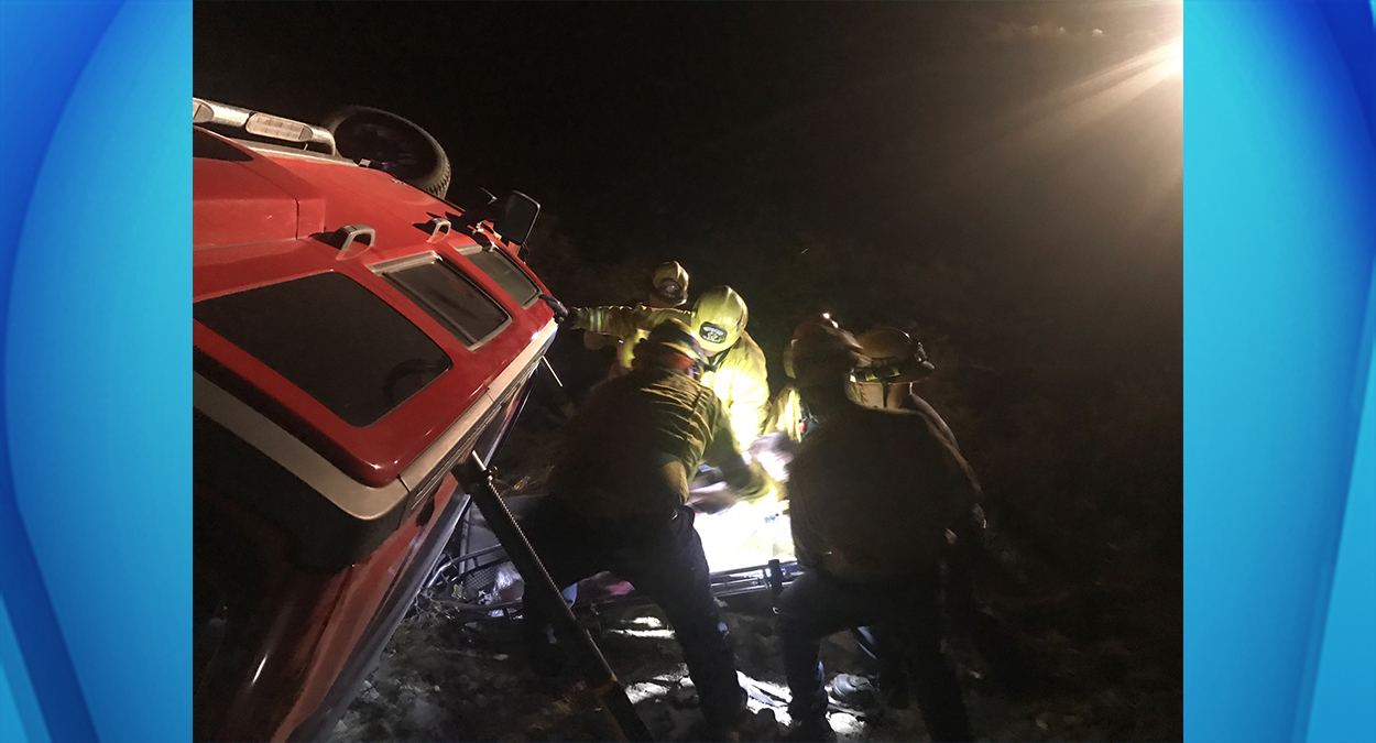 Firefighters found and rescued a woman on Saturday, Oct. 29, 2016, who was trapped in her Hummer five days after it rolled off a cliff in the mountains in San Bernardino County.