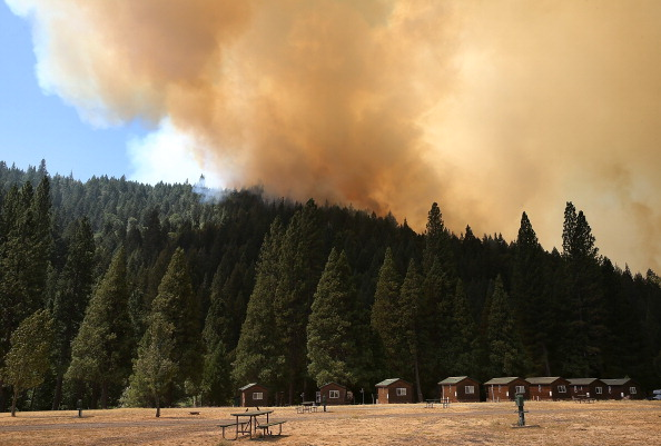 Stock photo - A plume of smoke rises from a ridge as the Rim Fire approaches Yosemite Lakes on August 23, 2013 near Groveland, California