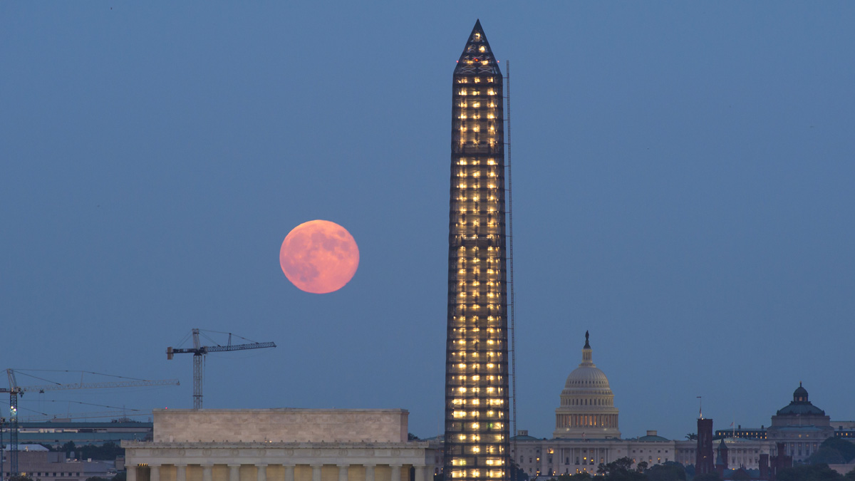 In this handout provided by the National Aeronautics and Space Administration, a full moon, or Harvest Moon, rises over government landmarks Lincoln Memorial, the Capitol buliding and the under-repair Washington Monument Sept. 19, 2013 in Washington, D.C.