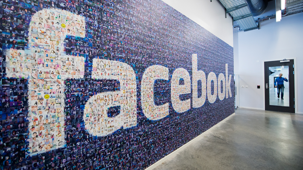 A big logo created from pictures of Facebook users worldwide is pictured in the company's Data Center, its first outside the U.S., on November 7, 2013, in Lulea, in Swedish Lapland.