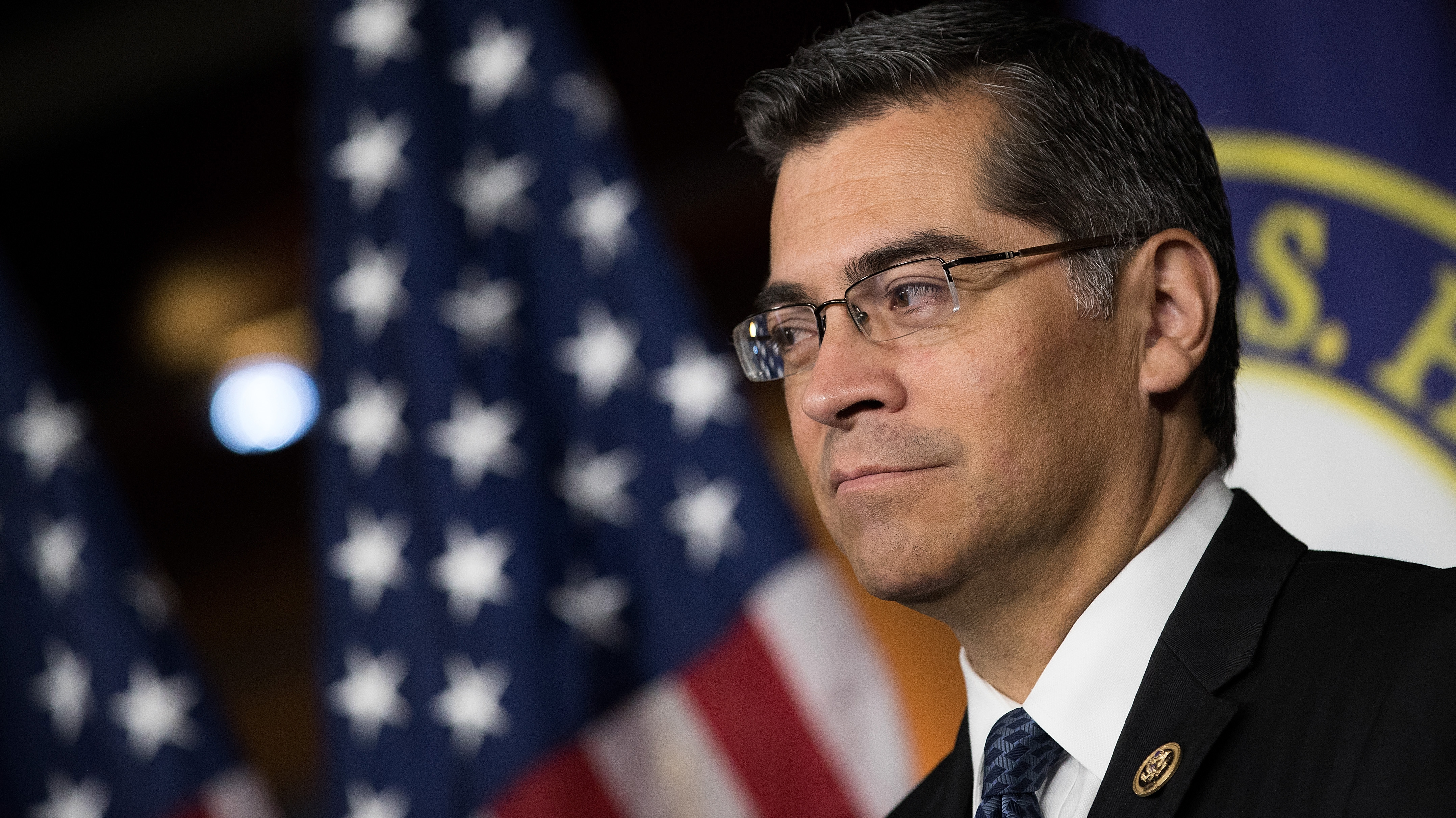 Rep. Xavier Becerra (D-CA) listens during a news conference to discuss the rhetoric of presidential candidate Donald Trump, at the U.S. Capitol, May 11, 2016, in Washington, D.C.