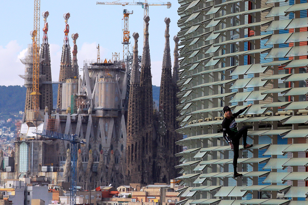 Alain Robert's latest stunt involved scaling the Agbar Tower with only hands and feet in Barcelona, Spain, on Nov. 25, 2016. The La Sagrada Familia Basilica designed by architect Antoni Gaudi can be seen in the background, left.