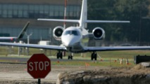 Woman Drives Over 2 NJ Airport Runways, Ditches Car and Runs